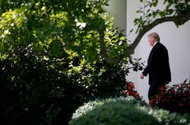 FILE - President Donald Trump walks from the Oval Office to the South Lawn of the White House in Washington, July 24, 2017.
