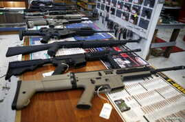 Guns for sale are displayed in the Roseburg Gun Shop in Roseburg, Oregon, Oct. 3, 2015.