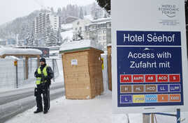 A police officer guards a checkpoint at the Seehof hotel during the World Economic Forum in Davos, Switzerland, Jan. 20, 2016.
