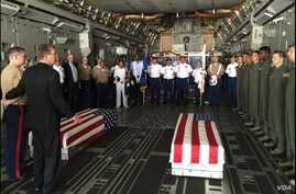 U.S. Defense Secretary Ash Carter, second left, with U.S. military members after they loaded the casket of what could be the remains of one to two crew members from a World War Two crash, in a C-17 aircraft, at Palam airport, in New Delhi, India, Apr