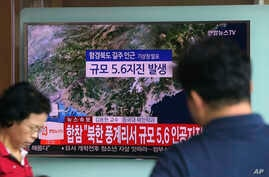 A man watches a TV reporting on a possible nuclear test conducted by North Korea at the Seoul Railway station in Seoul, South Korea, Sept. 3, 2017.