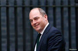 FILE - Ben Wallace, who then was parliamentary undersecretary of state for the Northern Ireland Office, is pictured as he arrives for a cabinet meeting at 10 Downing Street in London, May 12, 2015.
