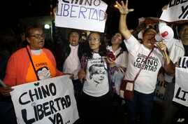 Supporters of former President Alberto Fujimori celebrate his medical pardon outside the clinic where the jailed leader was admitted the previous day after suffering a drop in blood pressure in Lima, Peru, Sunday, Dec. 24, 2017.