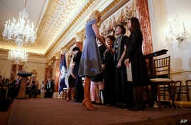 vanka Trump shakes hands with people honored for their work to stop human trafficking including Allison Lee, of Taiwan, and Boom Mosby, of Thailand, right, during a 2017 Trafficking in Persons Report ceremony at the State Department, June 27, 2017, i