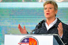 "NATO Deputy Secretary-General Rose Gottemoeller speaks during the International field exercise ""Crna Gora 2016,"" in Plavnica, near the Montenegro capital Podgorica, Nov. 3, 2016. Gottemoeller says that she expects the Balkan country to become a membe"