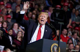 U.S. President Donald Trump speaks during a campaign rally in Grand Rapids, Mich., March 28, 2019.