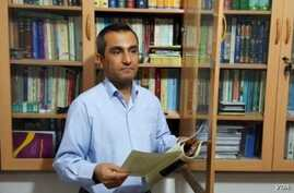 This undated photo shows Iranian Kurdish journalist and civil rights activist Ejlal Ghavami, who posted a tweet Aug. 14, 2018, saying he received a summons to be questioned by prosecutors in the northwestern city of Sanandaj in the next five days.