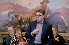 In this May 18, 2015 photo, former Texas Gov. Rick Perry addresses voters during a meet and greet event at Pizza Ranch in Sioux Center, Iowa.