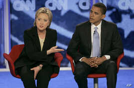 FILE - In this June 3, 2007 file photo, then-Democratic Presidential candidates, then-Sen. Hillary Clinton, D-N.Y., left, answers a question alongside then-Sen. Barack Obama, D-Ill. during the Democratic presidential primary debate in Manchester, N.H