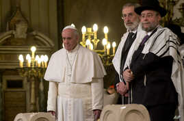 Pope Francis, left, flanked by Rabbi Riccardo Di Segni, listens to a chorus at the end of his visit to the Great Synagogue of Rome, Jan. 17, 2016. It was his first visit to a synagogue as pope.