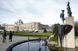 FILE -- A modern sculpture by Belgian artist Tom Frantzen shows former Belgian King Leopold II surrounded by animals and African warriors in the park of the Royal Museum for Central Africa in Tervuren, near Brussels, Jan. 22, 2014. After a remodel, t
