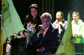 Lenin Moreno, candidate of the ruling PAIS Alliance Party, and his wife Rocio Gonzalez celebrate the early results of the presidential election with supporters in Quito, Ecuador, Feb. 19, 2017.