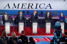 From right to left, Republican U.S. presidential candidates Dr. Ben Carson, businessman Donald Trump, former Florida Governor Jeb Bush, Wisconsin Governor Scott Walker, and former HP CEO Carly Fiorina  participate in the second official Republican ca