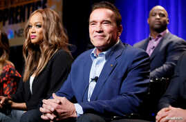 """FILE - Host Arnold Schwarzenegger (R) and Tyra Banks participate in a panel for """"The New Celebrity Apprentice"""" in Universal City, California, December 9, 2016."""
