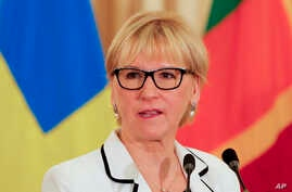 FILE - Swedish foreign minister Margot Wallstrom speaks to reporters.
