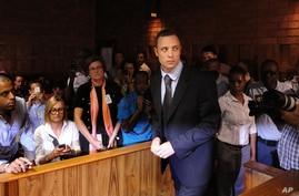 Olympic athlete, Oscar Pistorius , in court Friday Feb. 22, 2013 in Pretoria, South Africa, for his bail hearing charged with the shooting death of his girlfriend, Reeva Steenkamp.