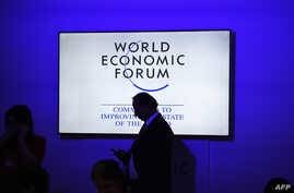Participants and visitors arrive at the India Economic Summit, hosted by the World Economic Forum, in New Delhi on October 6, 2017.