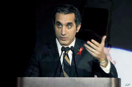 Egyptian TV host Bassem Youssef addresses attendants at a gala dinner party in Cairo, Egypt, Dec. 8, 2013.