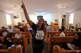In this Aug. 22, 2018, photo Black Voters Matter co-founder LaTosha Brown speaks at a church as part of The South Rising Tour 2018 in Warner Robins, Ga.