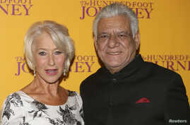 "Cast members Helen Mirren and Om Puri arrive for the British gala screening of ""The Hundred-Foot Journey"" in London, Sept. 3, 2014."