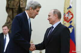 Russian President Vladimir Putin (R) welcomes U.S. Secretary of State John Kerry during a meeting at the Kremlin in Moscow, Russia Dec. 15, 2015.