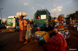 People are pictured at a mini bus station in Bamako, Mali. July 24, 2018.