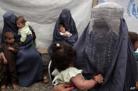 Returning Afghan refugees, who have recently arrived from Pakistan, wait during the registration process at a United Nations High Commissioner for Refugees (UNHCR) center on the outskirts of Kabul, Afghanistan, June 20, 2013.