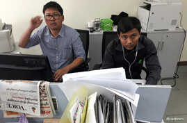 Reuters journalists Wa Lone, left, and Kyaw Soe Oo, who are based in Myanmar, pose for a picture at the Reuters office in Yangon, Myanmar, Dec. 11, 2017.