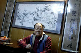 "Chinese writer Mo Yan smiles during an interview at his house in Beijing December 24, 2009. Mo Yan won the 2012 Nobel prize for literature on October 11, 2012 for works which the awarding committee said had qualities of ""hallucinatory realism""."
