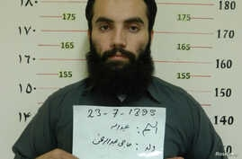 Anas Haqqani, a senior leader of the Haqqani network, arrested by the Afghan Intelligence Service (NDS) in Khost province is seen in this handout picture released October 16, 2014. Afghan forces arrested the son of the feared Haqqani network's founde