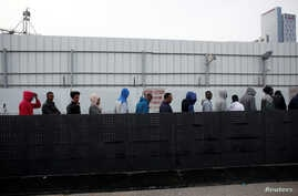 African migrants wait in line for the opening of the Population and Immigration Authority office in Bnei Brak, Israel, Feb. 4, 2018.