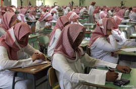 FILE - Secondary students sit for an exam in a government school in Riyadh, June 15, 2008.