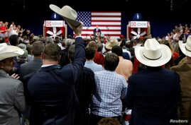 A supporter raises his cowboy hat as U.S. President Donald Trump speaks about tax reform during a visit to Loren Cook Company in Springfield, Missouri, Aug. 30, 2017.