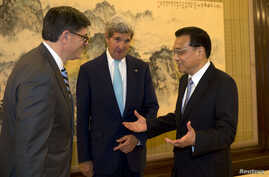 Chinese Premier Li Keqiang, right, speaks to U.S. Treasury Secretary Jack Lew, left, and U.S. Secretary of State John Kerry, center, during a meeting at the Zhongnanhai leadership compound in Beijing, China, July 10, 2014.