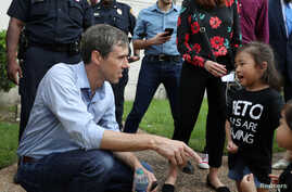U.S. Rep. Beto O'Rourke, running for the U.S. Senate seat, greets a young supporter following a campaign rally at Texas Southern University in Houston, Texas, Oct. 9, 2018.