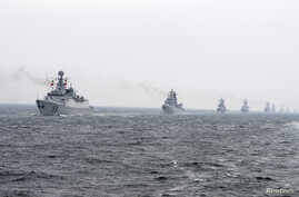 Chinese Navy warships take part in an international fleet review, April 23, 2009.