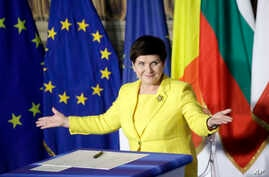 Polish Prime Minister Beata Szydto gestures after signing a declaration during an EU summit meeting at the Orazi and Curiazi Hall in the Palazzo dei Conservatori in Rome, March 25, 2017.
