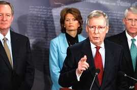 Senate Minority Leader Mitch McConnell (second from r) briefs the media about his congressional delegation's recently completed trip to Afghanistan and Pakistan as Sen. Mike Crapo (left), Sen. Lisa Murkowski and Sen. Roger Wicker (right) listen, 12 J