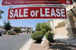 A home is seen for sale in Gilbert, Arizona, July 30, 2013.