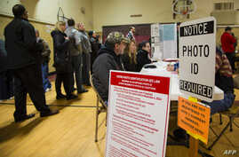 Voters take to the polls in Wauwatosa, Wis., April 5, 2016. Republicans and Democrats both cast their votes in Tuesday's presidential primaries.