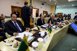 Interior minister of Libya's Government of Nationa Accord (GNA) Aref El-Khoja (L) and French Interior Minister Gerard Collomb (2L) take part in the opening meeting on security attended by interior ministers from central Mediterranean countries, July