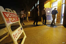 People line up to vote at a precinct in Matthews, N.C., March 15, 2016.