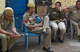 Delhi police personnel assemble in the neighborhood of the home of gang-rape accused Ram Singh who was found hanged in his cell in high security Tihar prison, in New Delhi, March 11, 2013.
