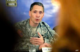 Col. Bradley Poppen answers a question during a news conference regarding Sgt. Bowe Bergdahl and the reintegration process, in San Antonio, Texas, June 13, 2014.