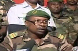 TV grab image taken from Euronews channel shows Colonel Abdoul Karim Goukoye Karimou , spokesman for the millitary junta delivering a televised statement in Niamey, 19 Feb 2010