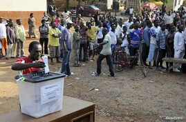 FILE - A man casts his vote at a polling station during presidential elections in Accra, Dec. 7, 2012.