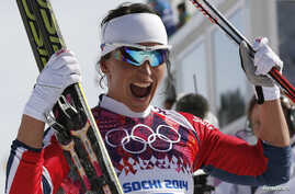 Norway's Marit Bjoergen celebrates after competing in the women's cross-country 30 km mass start free event at the Sochi 2014 Winter Olympic Games in Rosa Khutor, Russia, Feb. 22, 2014.
