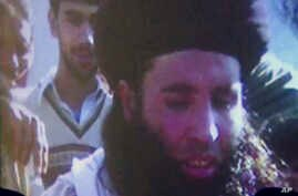 FILE - In this file image made from video broadcast on Thursday, Nov. 7, 2013, undated footage of Mullah Fazlullah is shown on a projector in Pakistan.