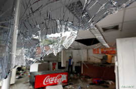 Broken glass is seen in a convenience store, after it was looted in Caracas, Venezuela, April 21, 2017.