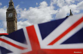 FILE - A union flag is seen near the Houses of Parliament in London, Britain, April 18, 2017.